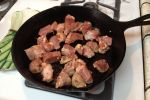 Chop pork into 1″ cubes, season generously with Cajun spice, and brown it in a dutch oven or skillet.